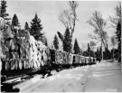 Lombard tractor hauling sleds of pulpwood, Magalloway Township, 1939