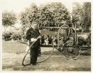 Woodbury K. Dana with cotton harvester, Westbrook, ca. 1918