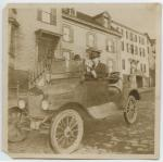 Lawrence R. Newell in automobile, Portland, ca. 1920
