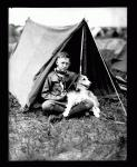 Boy Scout and dog, ca. 1935