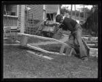 Boy building a soap box derby car, Portland, 1936