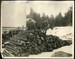 Andrew Smith at his woodpile, Swan's Island, ca. 1935