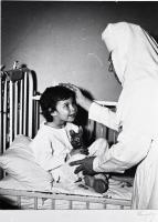Nurse with child patient at St. Joseph Hospital, Bangor, ca. 1960