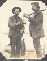 Two guides sharing a drink, Norcross, ca. 1900