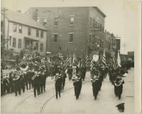 Painchaud's Band parading on Main Street, Biddeford, 1933