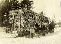 Horses and sled hauling logs, St. Agatha, ca. 1905