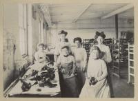 Women at Cummings Shoe Company worktable, South Berwick, ca. 1900