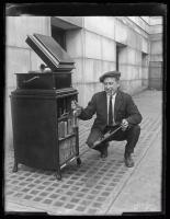 Man with cigar revealing secret liquor stash, Portland, ca. 1922