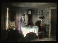 Woman in kitchen, West New Portland, ca. 1910