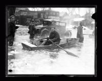 Man rowing during a flood, 1936