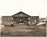 The National Youth Administration hangar with planes, Houlton, ca. 1940