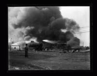 Spectator at oil fire, Kennebec Street, Portland, ca. 1935