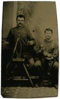 Two harnessmakers with their tools, ca. 1865