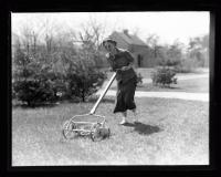 Woman mowing lawn, ca. 1935