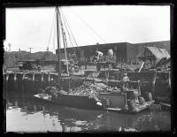 The Scow Vixen loaded with waste for disposal near Ram Island, Portland, 1925