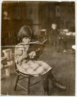 North School pupil reading, ca. 1910