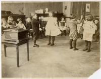 Primary students dancing, North School, ca. 1900