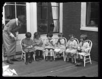 Children knitting at the Portland Day Nursery, Portland, 1923