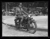 Policeman Carl Wibe riding a motorcycle, 1926