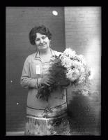 Myra Powers McLean holding a bouquet, 1926