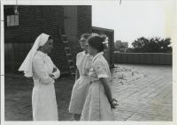 Mercy Hospital staff on roof, Portland, ca. 1975
