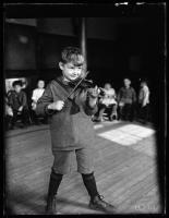 Boy playing violin, 1924