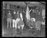 Men posing with a bluefin tuna, ca. 1935