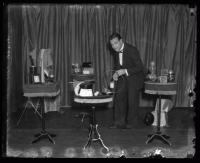 Roderick Macdonald Jr. setting up for a magic show, ca. 1922