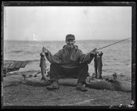 Phil James and his catch, ca. 1935
