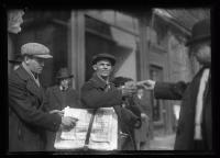 Man selling Evening Express, Portland, 1920