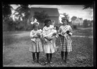 Three girls preparing for a Chapman school play, Portland, 1921