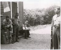 Soldiers with prisoner, ca. 1942