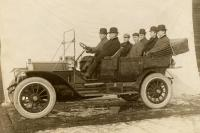 Men posing in a Knox touring car, c. 1909
