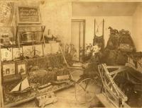 Merle P. Chaplin with toys, South Portland, ca. 1895
