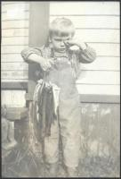 Linwood S. Elliot with fish, Patten, ca. 1913