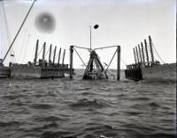 Raising the dredge, Portland Harbor, ca. 1900