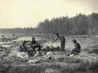 Guides fixing dinner, Roach Pond, 1894