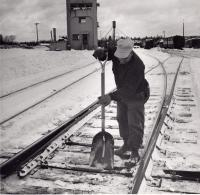 Removing ice from switch, Oakfield, c. 1960