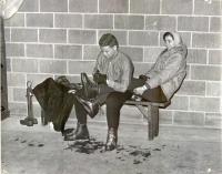 Lacing ski boots, Pleasant Mountain, ca. 1955
