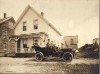 John Johnson at the wheel, New Sweden, ca. 1920