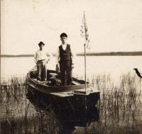 Two men in a boat, c. 1920