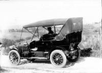Automobile on dirt road, ca. 1910
