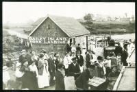 Passengers and islanders on wharf, Bailey Island, ca. 1910
