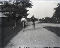 Herbert A. Coffin on bicycle, ca. 1900