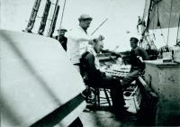 Dennis Cole giving Jonathan Cilley a haircut on deck, 1891