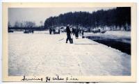Cutting ice on Cascade Pond.