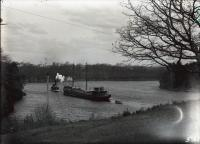 """Tug """"A.G. Prentiss"""" and barge on the Saco River, ca. 1913"""