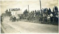 Race car crosses the finish line, Poland, June 17, 1911