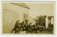 Lubec men sunning themselves, ca. 1915