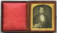 Craftsman holding tools, ca. 1845